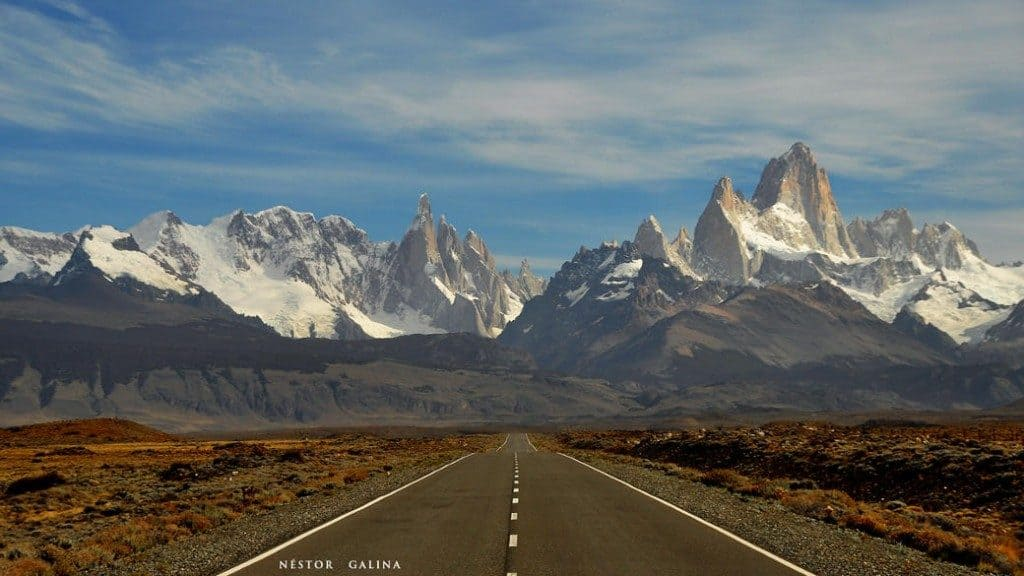 road leading to mountain peaks