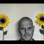 unhappy man with sunflowers