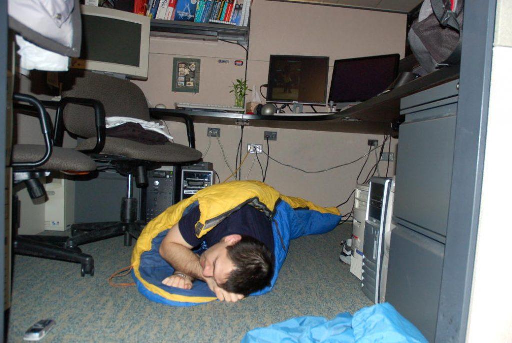 sleeping under work desk