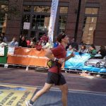 Dave crossing marathon finish line