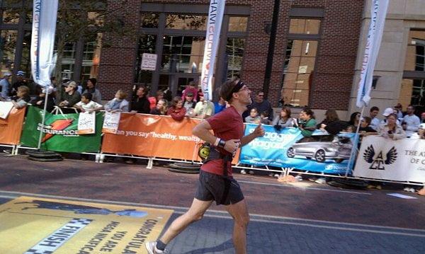 Dave crossing marathon finish line