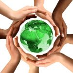 hands around globe