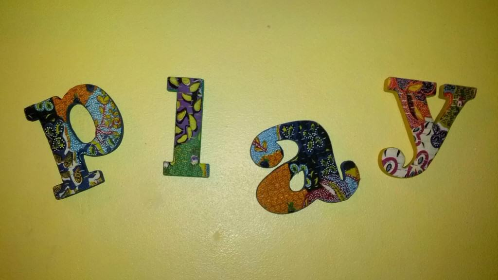play in colorfully patterned letters