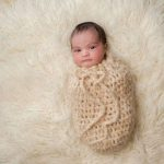 infant bundled in pouch